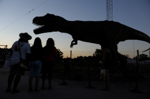 People looking at a dinosaur